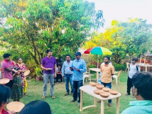NATURE FIRST ECO VILLAGE CEO P V HIREMATH DISTRIBUTING BIRD FEEDERS AND WATER BOWLS TO VISITORS FREE OF COST (5)